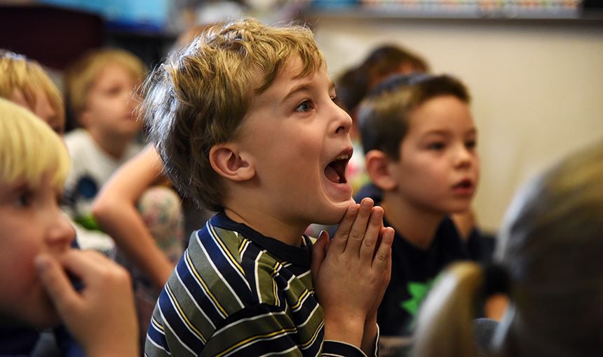 Liam Bartos, 7, MRES first-grader, listens to a story Dec. 1.
