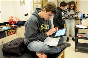 Eighth-grader Cristian Worley, 13, writes an email to a member of the International Astronomical Union Feb. 26.