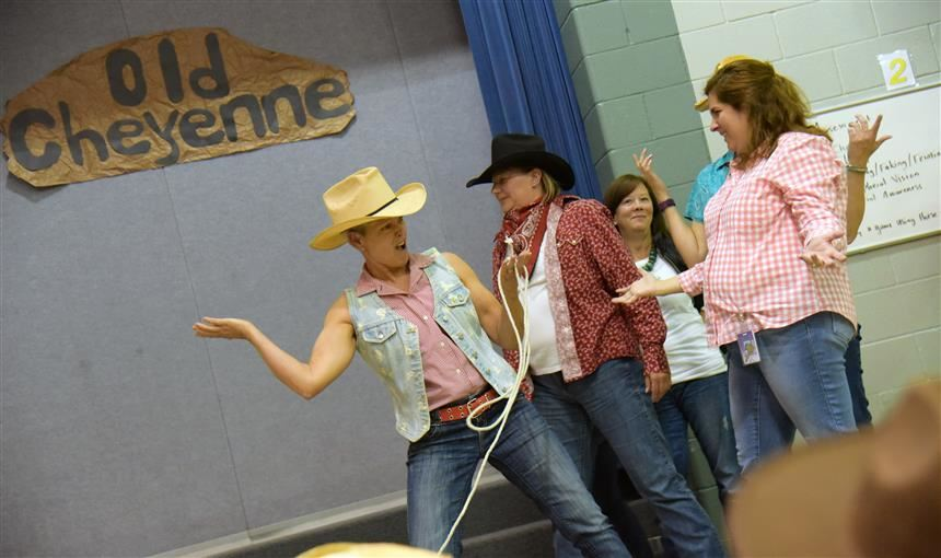 "Staff at SRES portray cowboys in their performance of the book, ""Pirates Versus Cowboys"" Sept. 26."