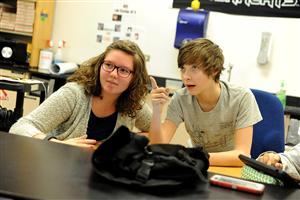 Eighth-grader Summer Brownsberger, 13, and Ryan Foster, 13, study a professional letter template.