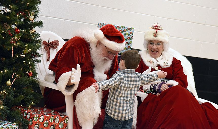 Mr. and Mrs. Claus welcome a young foster child Dec. 9.