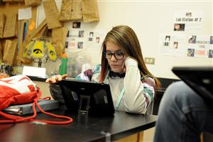Eighth-grader Heather Sullivan, 13, writes an email to a member of the International Astronomical Union