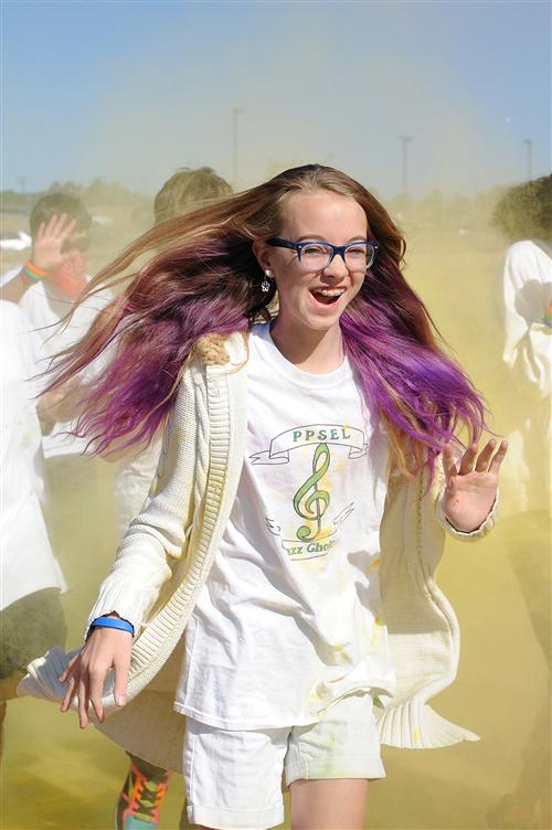 Eighth-grader Katiana Hanson, 13, , participates in a color run Sept. 25 at Pikes Peak School of Expeditionary Learning.