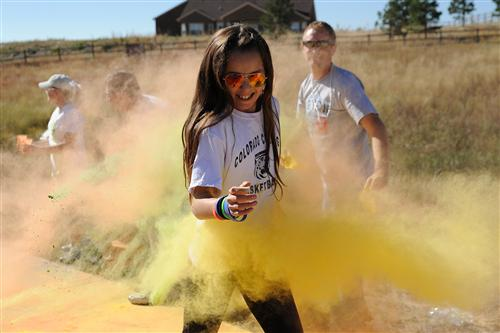 Sixth-grader Emma Howard, 11, participates in a color run Sept. 25 at Pikes Peak School of Expeditionary Learning.