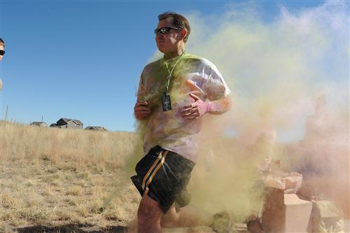 Principal Don Knapp participates in a color run Sept. 25 at Pikes Peak School of Expeditionary Learning.