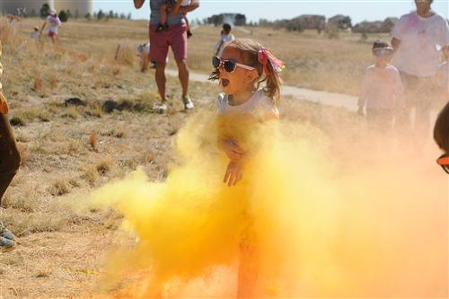 Kindergartener Arianna Thogode, 5, participates in a color run Sept. 25 at Pikes Peak School of Expeditionary Learning.