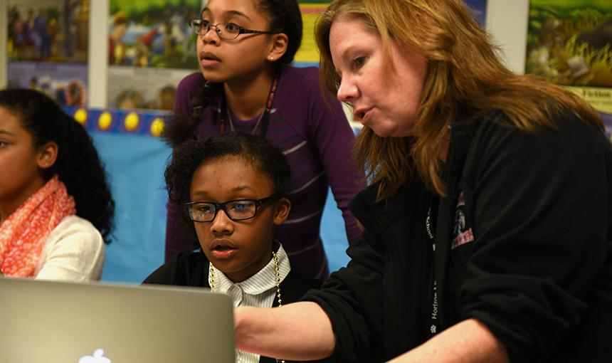 Sixth graders Ayshiyon Woods and Jahzara Davis work with Kittrie Glen.