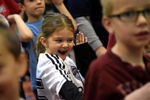 SES first-grader Emmy Sills, 7, dances during a Let's Move! Active Schools awards assembly Dec. 14.