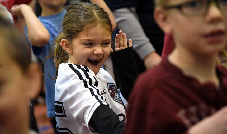 Stetson Elementary School first-grader Emmy Sills, 7, dances during a 'Let's Move!' assembly.