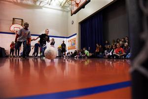 SES third-graders Anaz Bryan, 9, and Dylan Skinner, 9, chase a loose soccer ball during a Dec. 14 Let's Move! assembly.