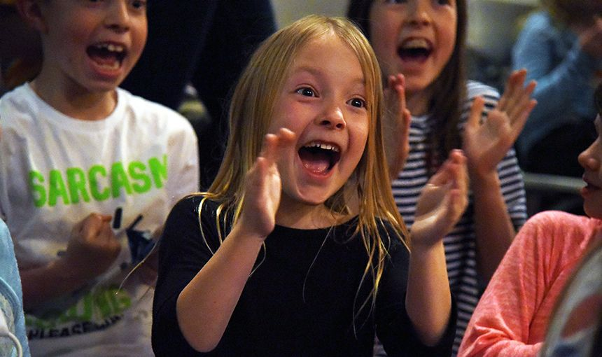 MRES second-grader Reagan Koch, 8, cheers during the PTA annual talent show March 3.