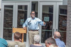 D49 Chief Education Officer Peter Hilts speaks to guests at IVES ribbon-cutting ceremony July 22