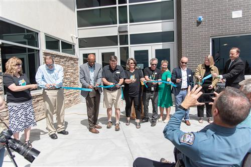 School leaders and guests cut ribbon during ceremony at Inspiration View Elementary School July 22