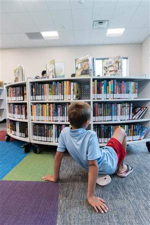 D49 student explores the new library at Inspiration View Elementary School July 22