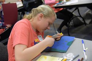 Sydney Newberg, 13, seventh-grader at SMS, lights up her artwork at a session at the Girls' STEM Experience at UCCS Feb. 1.