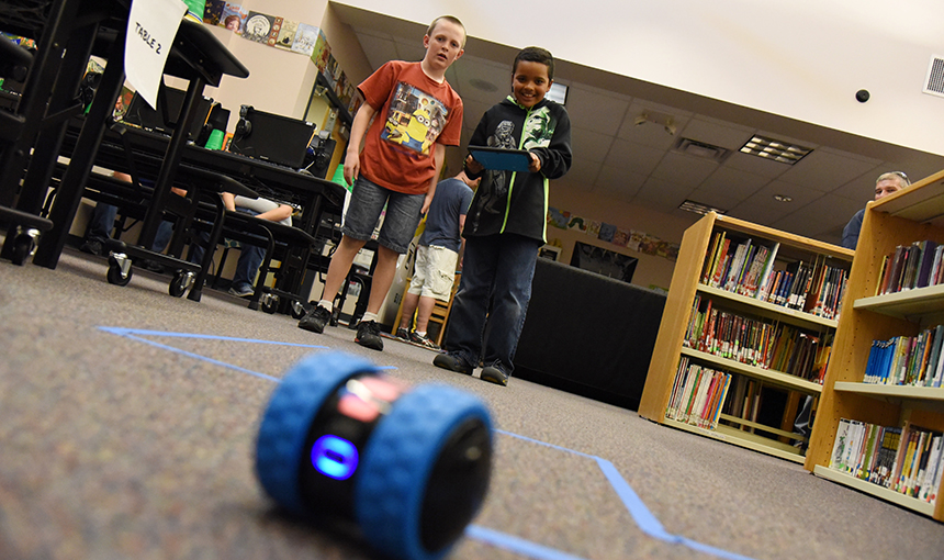 Ridgeview Elementary School fourth-grader Jacob Jackson, 9, steers a remote control robot May 4.