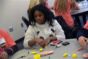 Naomi Lovitt, 12, seventh-grader at SMS, assembles her circuit at the Girls' STEM Experience at UCCS Feb. 1.