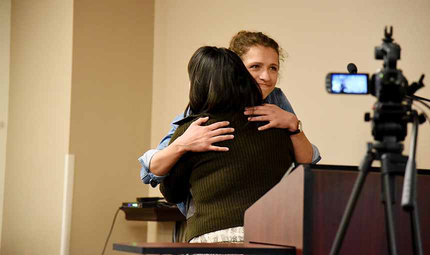 Grace Quereau, 18, twelfth-grader at SCHS, hugs her school counselor, Alexis Corral May 11.