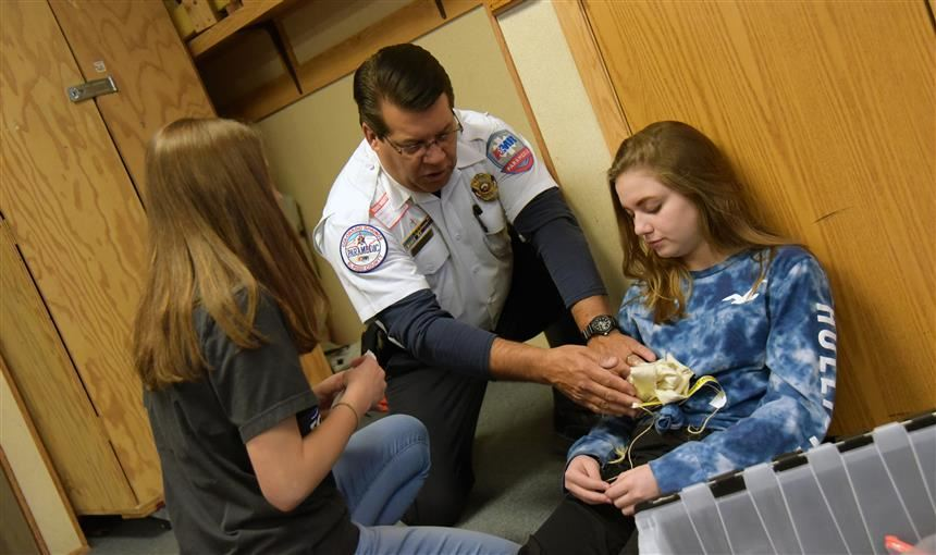 Students practice emergency medical skills during mock disaster drill at HMS March 7.