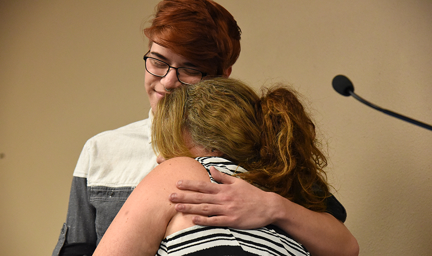 Jake Marvin, 18, twelfth-grader at SSAE, embraces math instructor Stephanie Danford May 11.