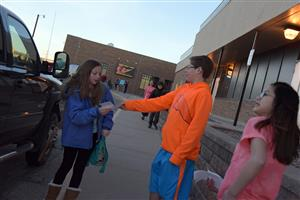 "Riley Spurlock, 12, sixth-grader, is welcomed to school by Firebird Ambassadors during the ""walk up"" at FMS March 14."