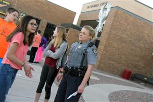 "Chloe Taylor, 13, eighth-grader, talks with Deputy Kristyn Nordeman at the ""walk up"" at Falcon Middle School March 14."