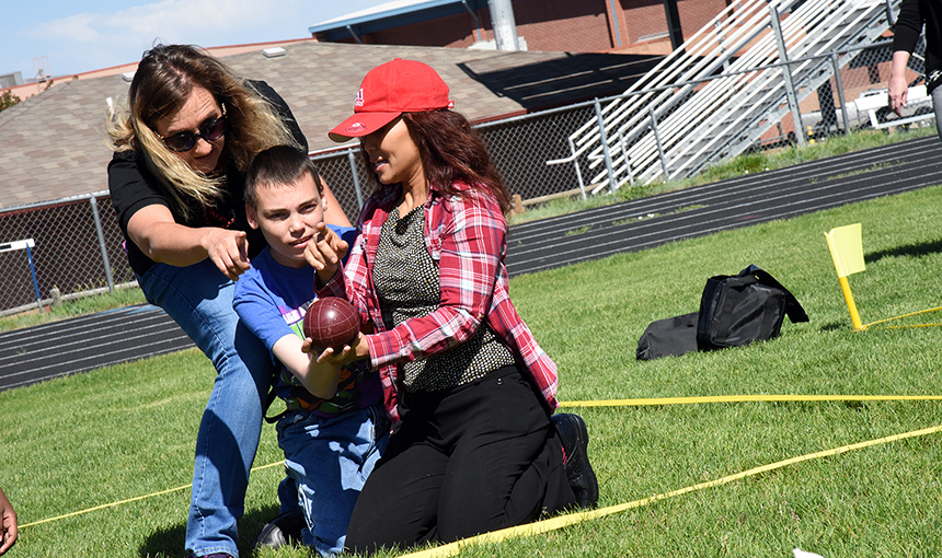 Students with special needs play bocce ball at Sand Creek High School June 7 during ESY.