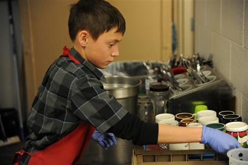 Eighth-grader Sebastian Hill, 13, organizes mugs Nov. 5 at the Marion House Soup Kitchen.