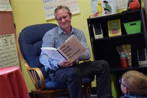 Dr. Mike Pickering, POWER Zone leader, participates as a guest reader at SES May 15.