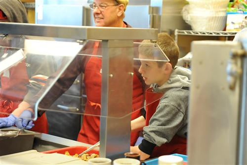 Eighth-grader Chad Turner, 13, serves food Nov. 5 at the Marion House Soup Kitchen.