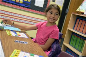 Sophia Patterson, 8, second-grader, plays math bingo at Learning Through the Decades event at SES May 15.