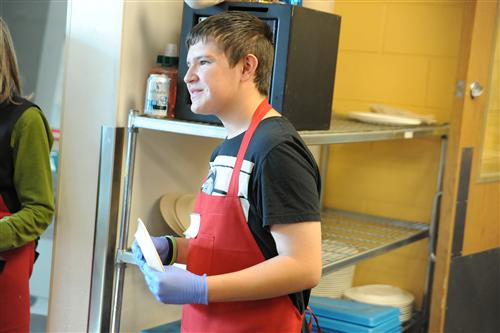 Eighth-grader Joseph Najar, 13, greets patrons Nov. 5 at the Marion House Soup Kitchen.