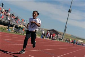 Isabella Glover races in a relay at the district track meet May 17 at FHS.