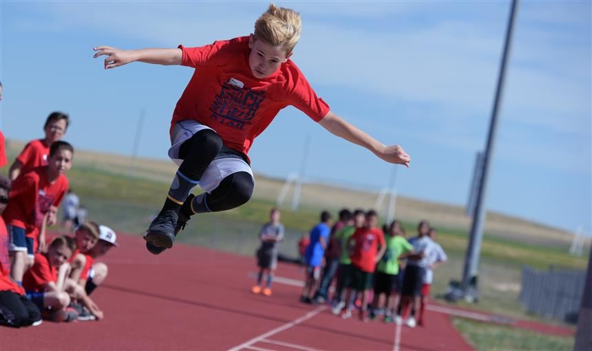 Ethan Falkenberg participates in the long jump event at the district track meet at FHS on May 17.