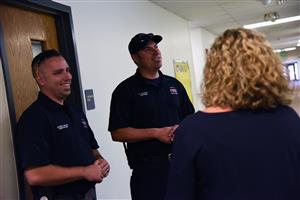 Members of the Falcon Fire Department discuss emergency planning for the year ahead with Sheehan Freeman-Todd Aug 1.