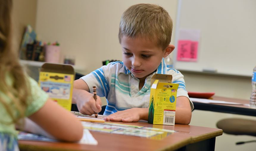 Connor Wall, 6, OES first-grader, concentrates on the first day of school Aug 2.
