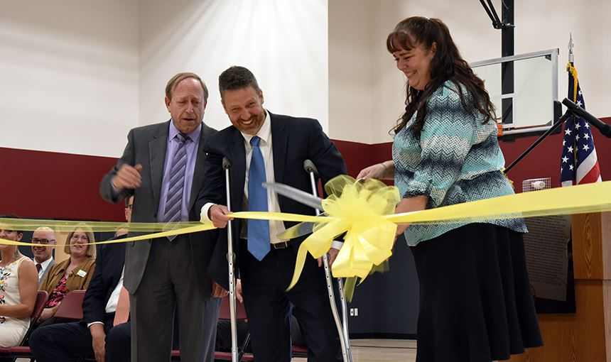 Colorado Springs mayor John Suthers, helps BLPA leaders on how to cut the ribbon Aug. 4.