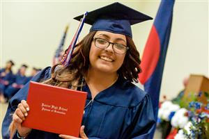 Student receives her diploma at the PHS graduation May 18 at Creekside Success Center.