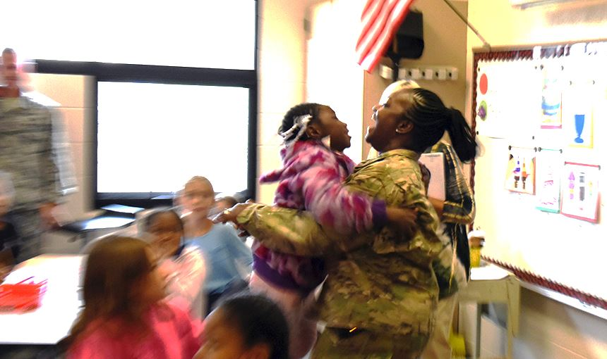 Eliana Burrs, 7, a third-grader at MRES jumps into her mother's arms during a surprise reunion, 8/7