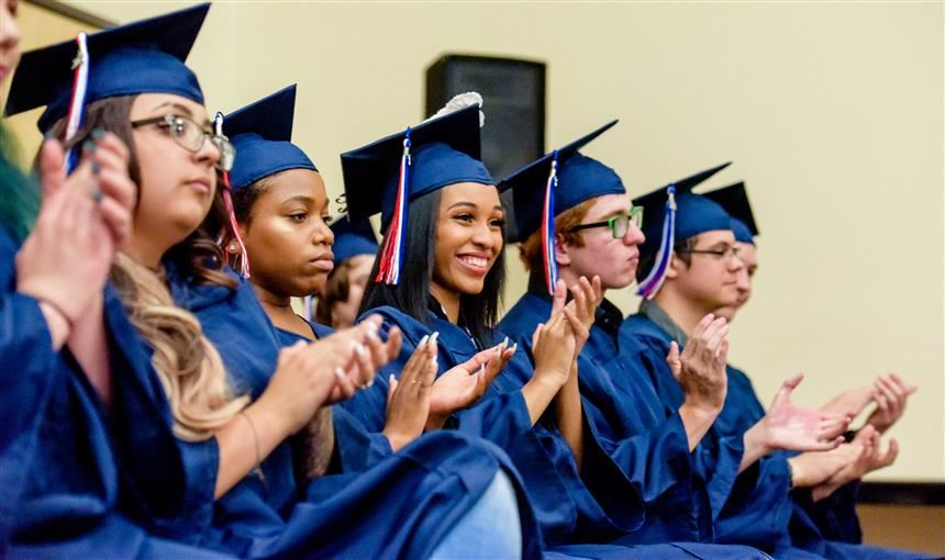 PHS graduates await receiving their diplomas May 18 at the Creekside Success Center.