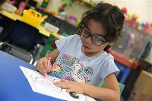 Jayla Contreras-Sandoval works intentionally on her coloring project during kindergarten orientation at FESoT Aug. 1.