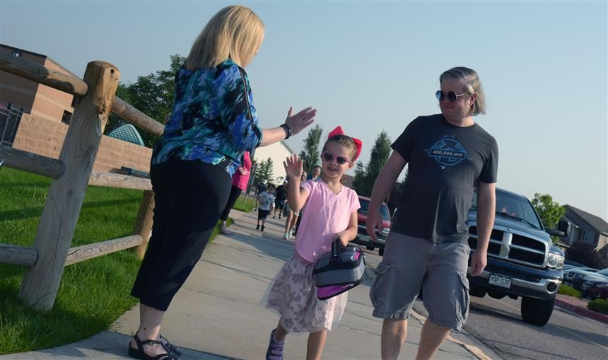 Janell Pryor, kindergartner, greets the principal as she heads to her first day at WHES Aug. 2.