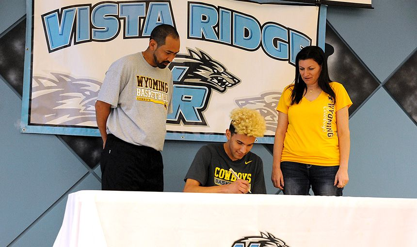 Twelfth-grader Hunter Maldonado, 17, signs a letter of intent Nov. 9 during National Signing Day.