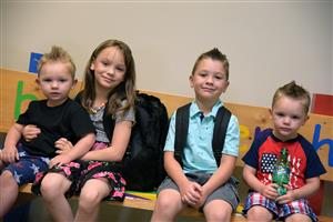 The Weatherby children patiently wait to enter their classrooms on the first day of school at WHES Aug. 2.