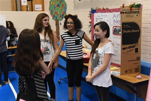 Students Share Interactive Projects During IB Exhibition