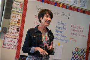 Lisa Jones, first grade teacher, talks to learners during Family Orientation at SES Aug. 2.
