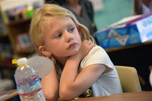 Danielle Rymer, first-grader, listens intently to her teacher, Lisa Jones, during Family Orientation Day at SES Aug. 2.