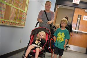 The Thompson Family, new to the SES family, enjoys touring the school Aug. 2 during Family Orientation Day.