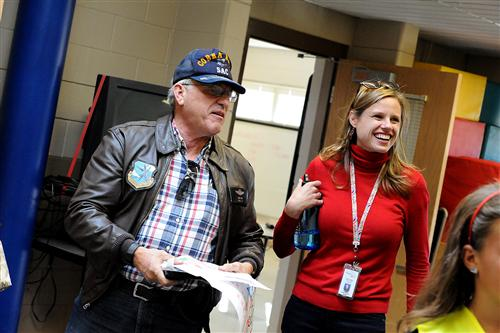 "Air Force Veteran Greg Smith and Kathy Pickering, principal, participate in an ""American Walk""."