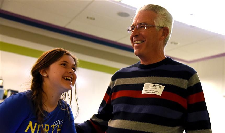 Karsyn McCune, MRES fifth-grader and retired teacher Douglas Downey share a laugh March 4.